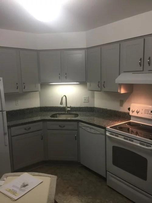 Cabinet refacinglight gray with granite countertops