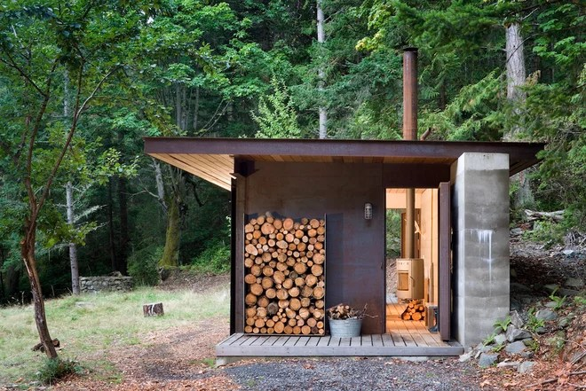 Rustic Exterior by Terra Firma Builders Ltd.