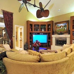 corner tv living room ideas furniture for cheap prices family photos houzz tropical open concept idea in tampa with beige walls a