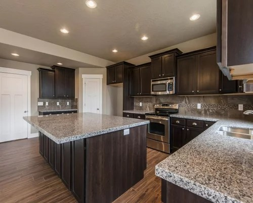 staining kitchen cabinets darker best appliances for the money new caledonia granite | houzz