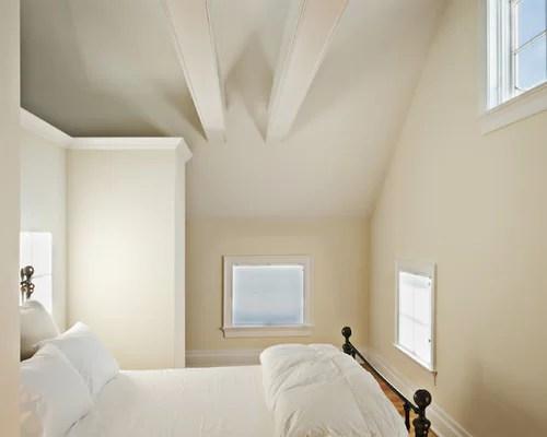 Farmhouse Medium Tone Wood Floor Bedroom Idea In New York With Beige Walls