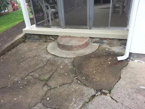 broken poured concrete patio
