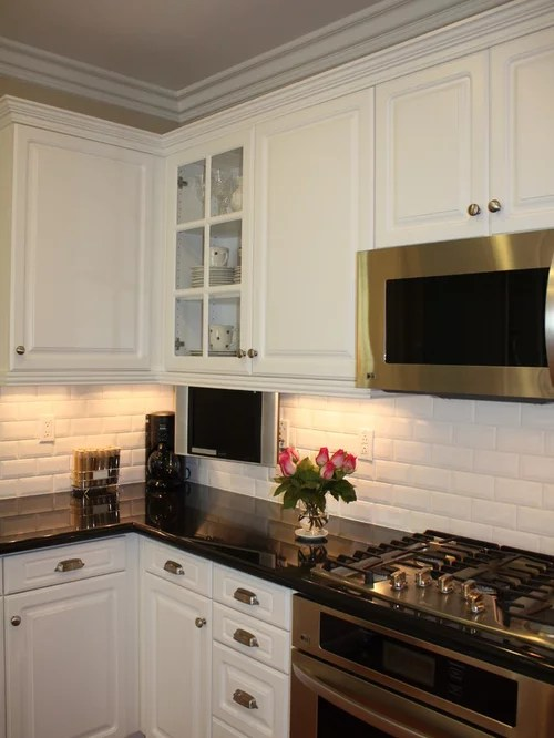 cream color kitchen cabinets country style beveled subway tile backsplash ideas, pictures, remodel ...