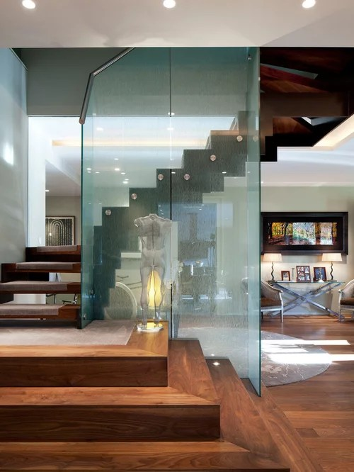 open plan staircase in living room shelf units for rooms glass partition wall | houzz