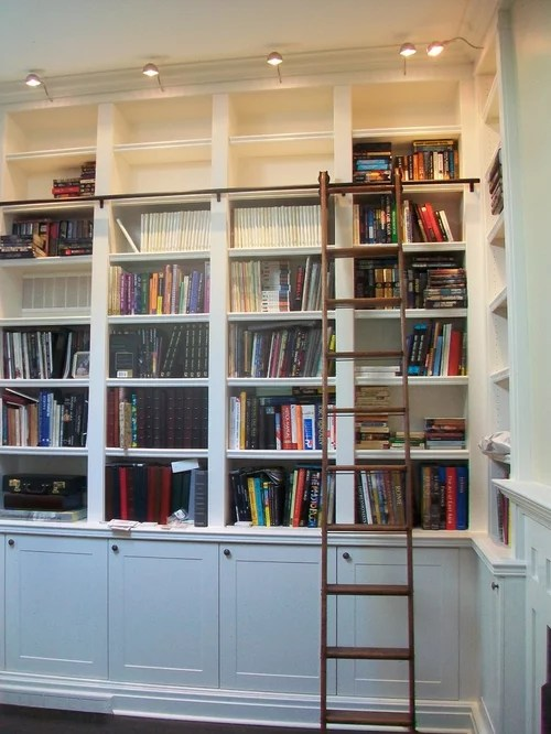 Builtin Bookcases With Rolling Library Ladder