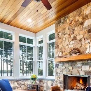 Foto e Idee per Verande  veranda in montagna con camino