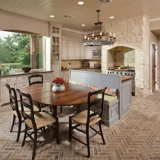 brick floor kitchen breakfast table houzz example of a large tuscan and brown dining room combo design