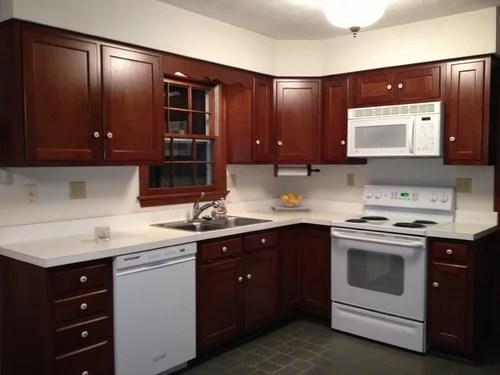 Brown Cabinets White Corian Countertop W White Appliances
