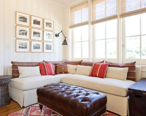 dark blue sofa living room tables for ideas couch against window | houzz