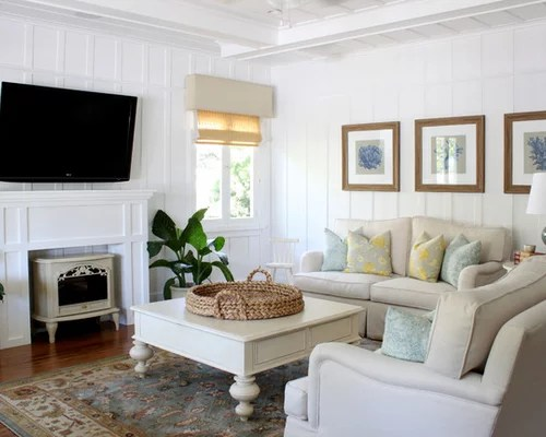 how to decorate a living room with fireplace and tv yellow walls wall decor | houzz