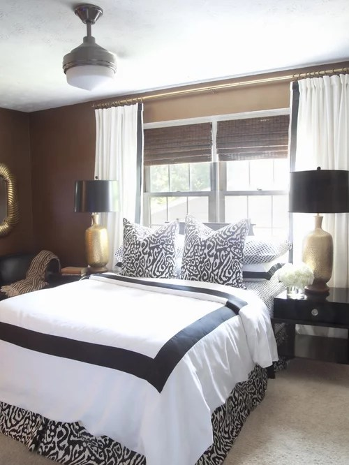 With a colorful or strong choice of curtains framing the bed, the window, the curtains and everything in between become one big and bold visual focal point. Bed Under Window | Houzz