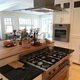 kitchen island stove amazon appliances center with houzz eat in mid sized traditional u shaped light wood floor