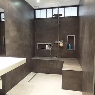 idees deco pour une salle de bain moderne de taille moyenne avec un carrelage gris
