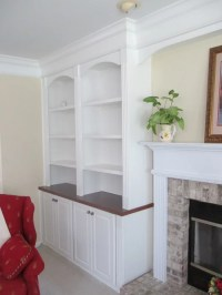 White Painted Raised Panel Bookcases with stained wood tops