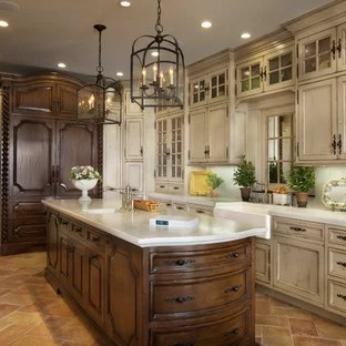 antiqued kitchen cabinets with glass distressed houzz large mediterranean enclosed appliance example of a tuscan u shaped travertine floor