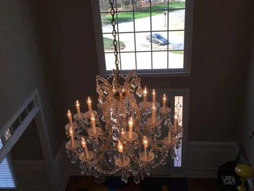 chandelier in a two story average foyer