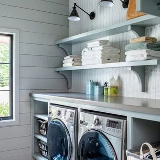 Example Of A Country Gray Floor Laundry Room Design In Atlanta With Open Cabinets Blue