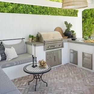 patio kitchen pics of cabinets 75 most popular design ideas for 2019 stylish coastal backyard brick photo in orange county with a gazebo