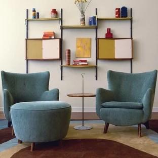 living room cabinet design ideas modern with dark grey sofa hanging photos houzz 1960s photo in new york beige walls