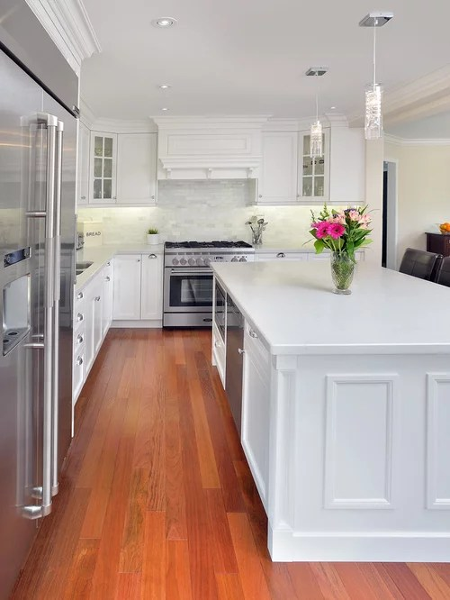 aristokraft kitchen cabinets peerless faucets caesarstone frosty carrina backsplash | houzz
