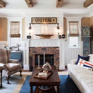 cape cod style house living room furniture groups houzz inspiration for a beach enclosed remodel in los angeles with standard fireplace save photo
