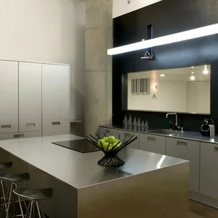kitchen cupboard jamaica black subway tile ideas photos houzz industrial inspiration for an galley remodel in san francisco with stainless