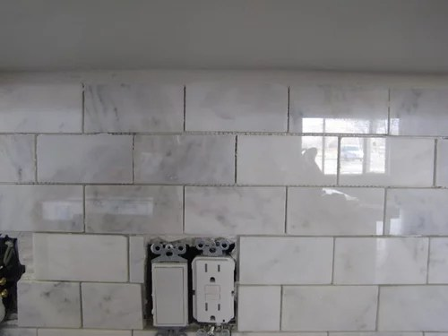 do i need trim tile under the cabinets