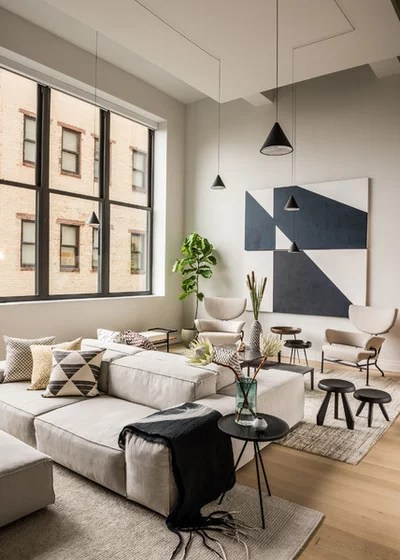 how to decorate a large living room with little furniture leather couches for 13 strategies making feel comfortable contemporary by atelier armbruster