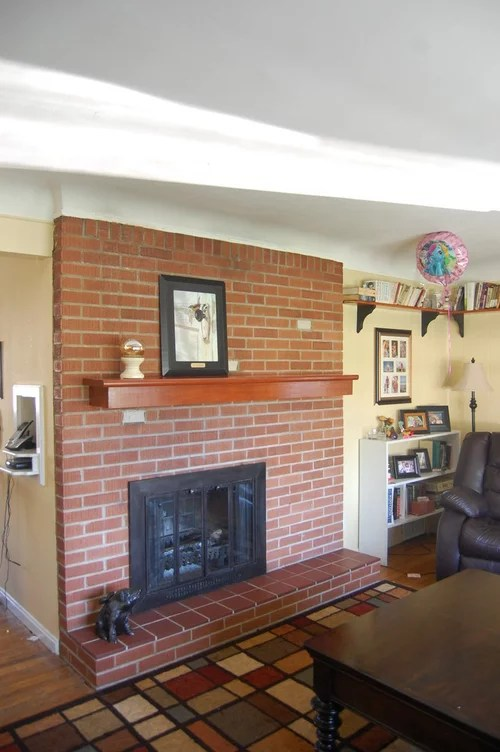 living room fireplace off centered curtains for yellow center box please help
