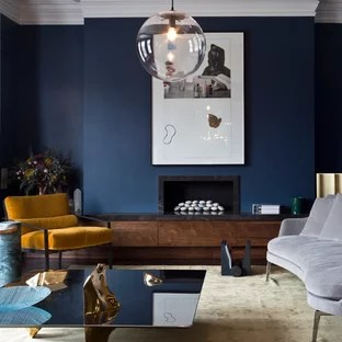contemporary living room with electric fireplace painting my white modern ideas and photos houzz inspiration for a formal in london blue walls ribbon