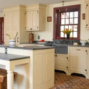 brick floor kitchen online design tool houzz example of a mid sized country single wall and red eat