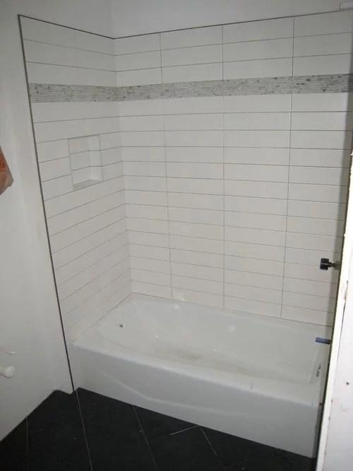 how far tile extends from bathtub