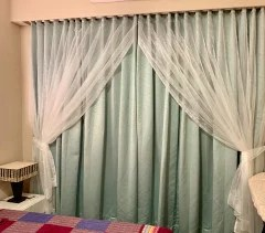 can i hang sheers behind drapes without