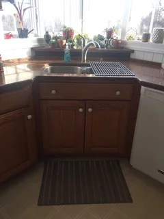 rug or mat for the corner sink in kitchen