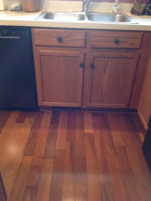 moen kitchen sink ninja system pulse gingersnap maple cabinets with beige quartz countertop ...
