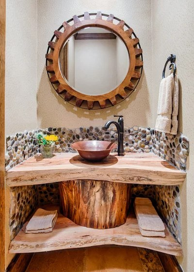 Rustic Powder Room by By Design Interiors, Inc