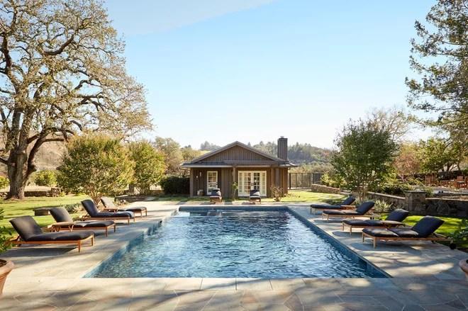Farmhouse Pool by JKT Associates, Inc.