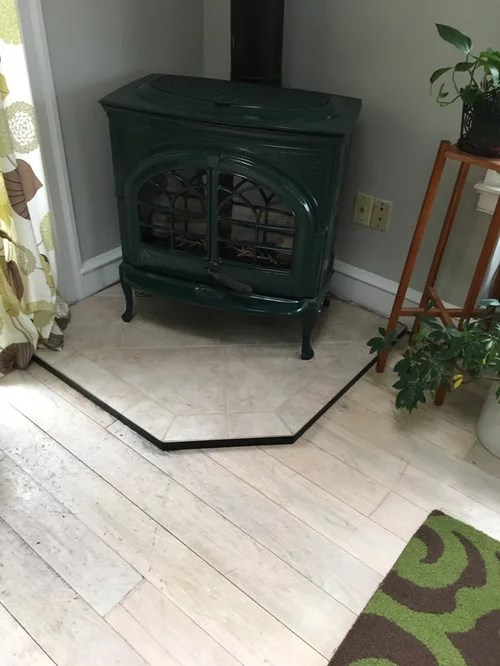 flooring goes under pot belly stove