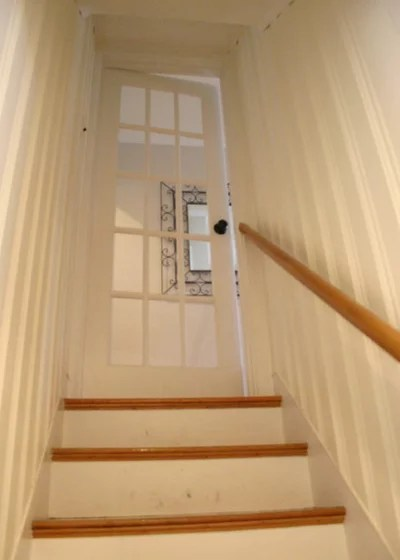 Knotty to Nice Painted Wood Paneling Lightens a Rooms Look