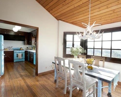 Inspiration For A Rustic Medium Tone Wood Floor Dining Room Remodel In New York With White