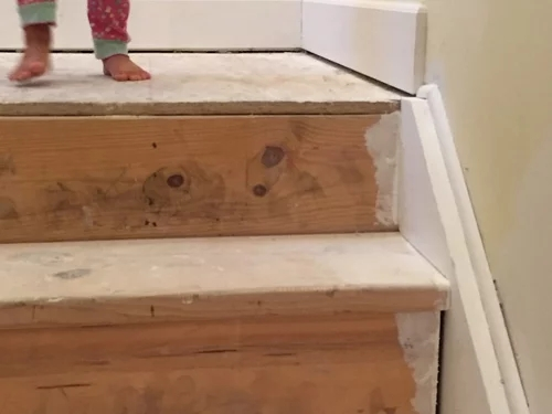 Baseboards Transition Down The Stairs | Tile To Wood Stair Transition | Builder Grade | Upstairs | Residential | Laminate | Entryway