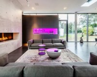 Wohnzimmer mit Kaminsims aus Stein und Betonboden Ideen