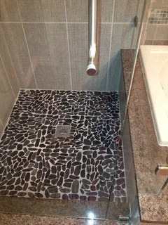 can i put pebble tile on shower floor