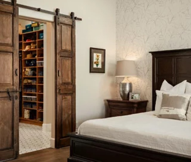 Example Of A Mid Sized Southwest Master Ceramic Floor And Brown Floor Bedroom Design In
