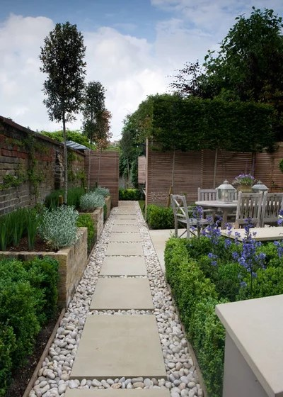 Traditional Landscape by Landscaping Solutions