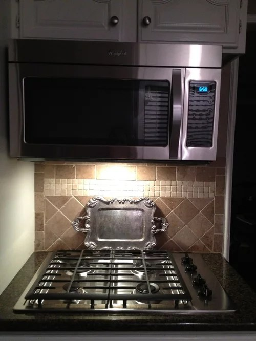 over range microwave side exposed