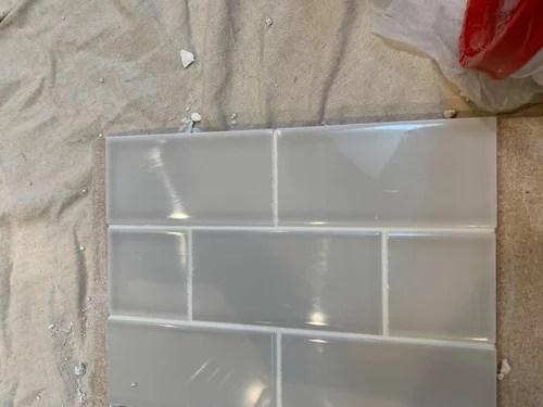 light gray subway tile backsplash