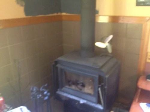can i paint tiles behind a wood stove