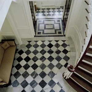 "Antique Reclaimed Spanish Grey and White marble - Antique black and white marble from Spanish manor houses and country estates provide a beautifully complementary floor surround. The unique black marble is in shades of grey making and elegan lower contrast checkerboard pattern. An all-white plain antique floor is also avaialble. Typically sourced in apx. 11"" x11"" or 16"" x 16"" and limited larger sizes can be used for stair tread and room partitioning."