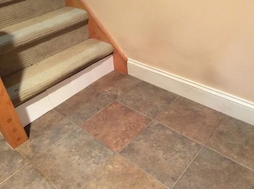Baseboard Transition From Floor To Stairs | Tile To Wood Stair Transition | Builder Grade | Upstairs | Residential | Laminate | Entryway